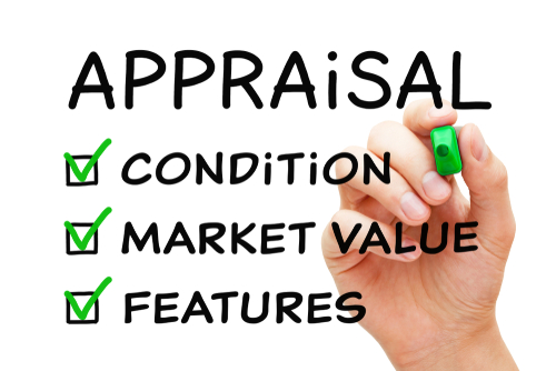 Hand-filling-Appraisal-checklist-business-concept-with-checked-boxes-on-condition-market-value and-features