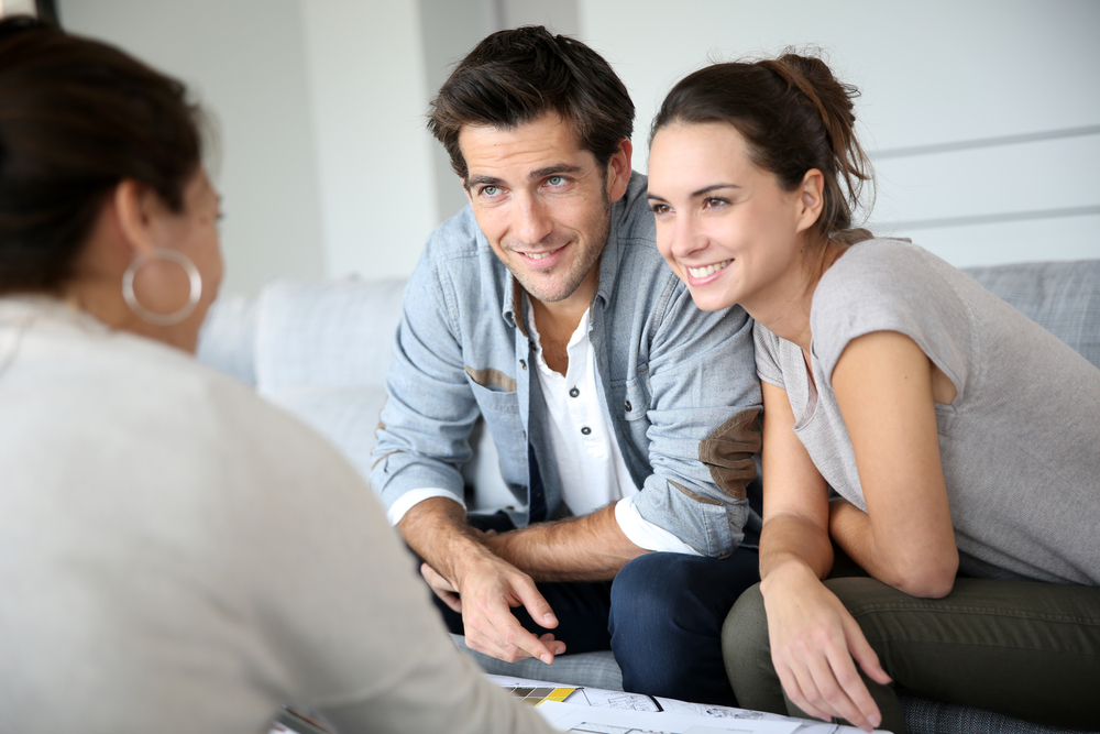 Couple meeting architect for house construction-1